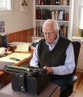 David McCullough at work on his typewriter